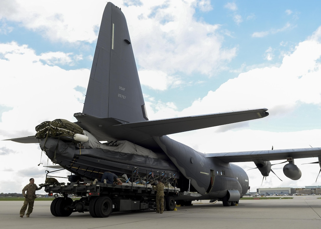 A Rigid Inflatable Boat is loaded into an MC-130J Commando II assigned to the 67th Special Operations Squadron during an exercise April 14, 2016, at Stuttgart Air Base, Germany. The preparations were made in order to conduct an airdrop mission with a U.S. Navy Maritime Craft Aerial Delivery System. (U.S. Air Force photo by Senior Airman Victoria H. Taylor/Released)