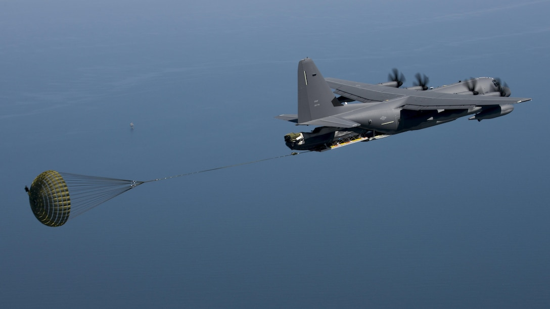 A U.S. Air Force MC-130J Commando II performs a Maritime Craft Aerial Delivery System drop during an exercise April 16, 2016, over the Black Sea. Airborne Systems MCADS is the only airdrop system currently in service that is capable of delivering large Rigid Inflatable Boats.(U.S. Air Force photo by Senior Airman Victoria H. Taylor/Released)