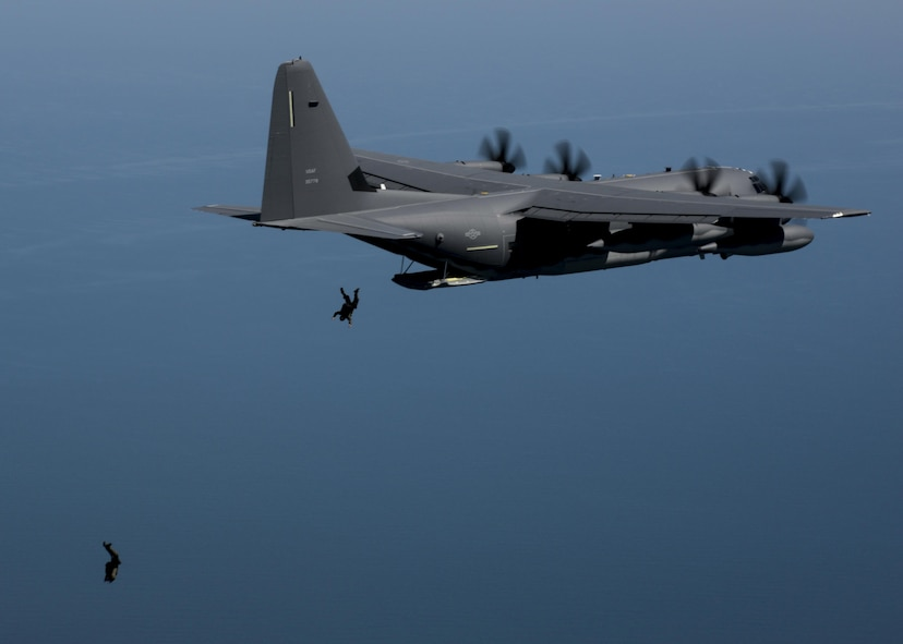 Members of the U.S. Navy Special Warfare Combatant-Craft unit perform high-altitude, low-opening parachute jumps from the back of a U.S. Air Force MC-130J Commando II during an exercise April 16, 2016, over the Black Sea. Airmen from RAF Mildenhall, England, worked with the Naval unit to deploy a large Rigid Inflatable boat off the coast of Bulgaria while merging the capabilities of the U.S. Air Force and the U.S. Navy. (U.S. Air Force photo by Senior Airman Victoria H. Taylor/Released)