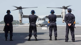 Japan Maritime Self-Defense Force officers watch as a U.S. Marine Corps MV-22B Osprey tiltrotor aircraft from Marine Medium Tiltrotor Squadron (VMM) 265 (Reinforced), 31st Marine Expeditionary Unit (MEU), refuels aboard the JS Hyuga (DDH 181), at sea, April 22, 2016. The Osprey received supplies from the Hyuga in support of the relief effort after a series of earthquakes struck the island of Kyushu. The 31st MEU is the only continually forward-deployed MEU and remains the Marine Corps' force-in-readiness in the Asia-Pacific region.