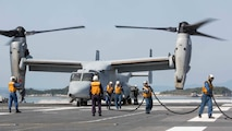 Japan Maritime Self-Defense Force personnel finish refueling a U.S. Marine Corps MV-22B Osprey tiltrotor aircraft from Marine Medium Tiltrotor Squadron (VMM) 265 (Reinforced), 31st Marine Expeditionary Unit (MEU), aboard the JS Hyuga (DDH 181), at sea, April 22, 2016. The Osprey received supplies from the Hyuga in support of the relief effort after a series of earthquakes struck the island of Kyushu. The 31st MEU is the only continually forward-deployed MEU and remains the Marine Corps' force-in-readiness in the Asia-Pacific region.