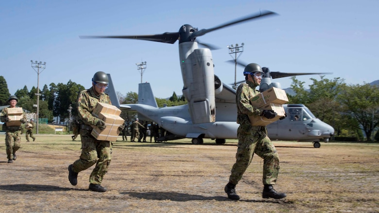 Japan Ground Self-Defense Force personnel carry supplies from a U.S. Marine Corps MV-22B Osprey tiltrotor aircraft from Marine Medium Tiltrotor Squadron (VMM) 265 (Reinforced), 31st Marine Expeditionary Unit (MEU), in Hakusui Sports Park, Kyushu island, Japan, April 22, 2016. The supplies are in support of the relief effort after a series of earthquakes struck the island of Kyushu. The 31st MEU is the only continually forward-deployed MEU and remains the Marine Corps' force-in-readiness in the Asia-Pacific region.
