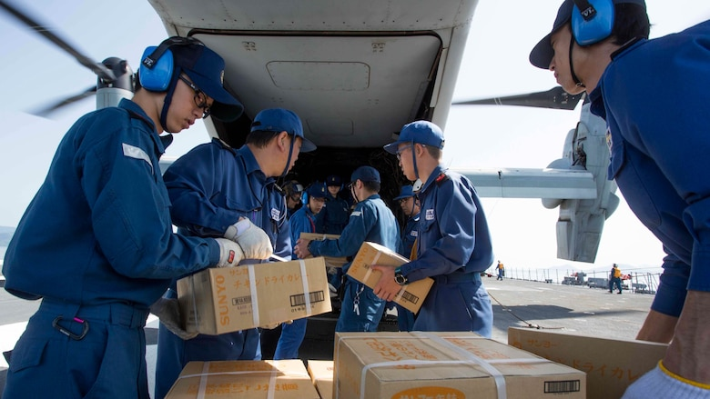 Japan Maritime Self-Defense Force personnel, U.S. Navy sailors and U.S. Marines load supplies onto a U.S. Marine Corps MV-22B Osprey tiltrotor aircraft from Marine Medium Tiltrotor Squadron (VMM) 265 (Reinforced), 31st Marine Expeditionary Unit (MEU) aboard the JS Hyuga (DDH 181), at sea, April 22, 2016. The supplies are in support of relief efforts after a series of earthquakes struck the island of Kyushu. The 31st MEU is the only continually forward-deployed MEU and remains the Marine Corps' force-in-readiness in the Asia-Pacific region.