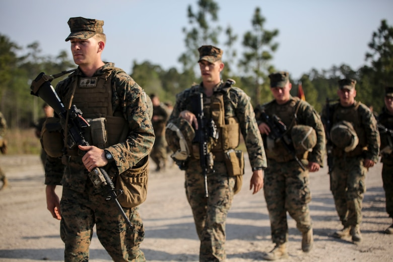 Marines with 2nd Combat Engineer Battalion conduct a hike to their new command post at Camp Lejeune, N.C., April 21, 2016. Upon reaching the command post, Maj. Gen. Brian Beaudreault, commanding general 2nd Marine Division, and Lt. Col. Gary A. McCullar, the commanding officer 2nd CEB, inaugurated the relocation by cutting barbed wire placed at the door. (U.S. Marine Corps photo by Cpl. Paul S. Martinez/Released)