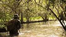 U.S. Marines with 2nd Battalion, 8th Marine Regiment divert from a trail that is known to have notional improvised explosive devices during an attack evolution at Marine Corps Base Camp Lejeune, N.C., April 20, 2016. Intelligence was gathered from an enemy guard causing the Marines to avoid the path to continue to the objective.