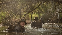 Cpl. Kody Biggs, a rifleman with 2nd Battalion, 8th Marine Regiment, makes his down river, around a trail that is known to have notional improvised explosive devices during an attack evolution at Marine Corps Base Camp Lejeune, N.C., April 20, 2016. The Marines conducted patrols, ambushes and assaults to prepare of their upcoming Integrated Training Exercise.