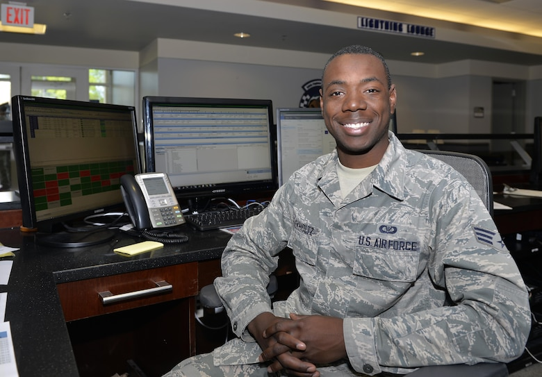 Senior Airman Markese Buckholtz, 58th FS aviation resource manager, sits at his desk at Eglin Air Force Base, Fla., March 30, 2016. Buckholtz will be attending Embry Riddle Aeronautical University in Prescott, Arizona as part of the Senior Leader Enlisted Commissioning Program. After spending a little over two years in the enlisted force, Buckholtz hopes to commission as an officer after receiving his degree and fly aircraft such as the F-35A Lightning II. (U.S. Air Force photo/Senior Airman Andrea Posey)