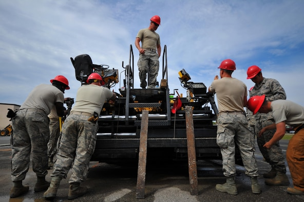 Airmen with various RED HORSE and Civil Engineering squadrons prepare to pave a parking lot on Hurlburt Field, Fla., April 20, 2016. As part of a two-week milling and paving training course, more than 20 Airmen from across the globe participated by laying asphalt to repair a parking lot. (U.S. Air Force photo by Airman 1st Class Joseph Pick)