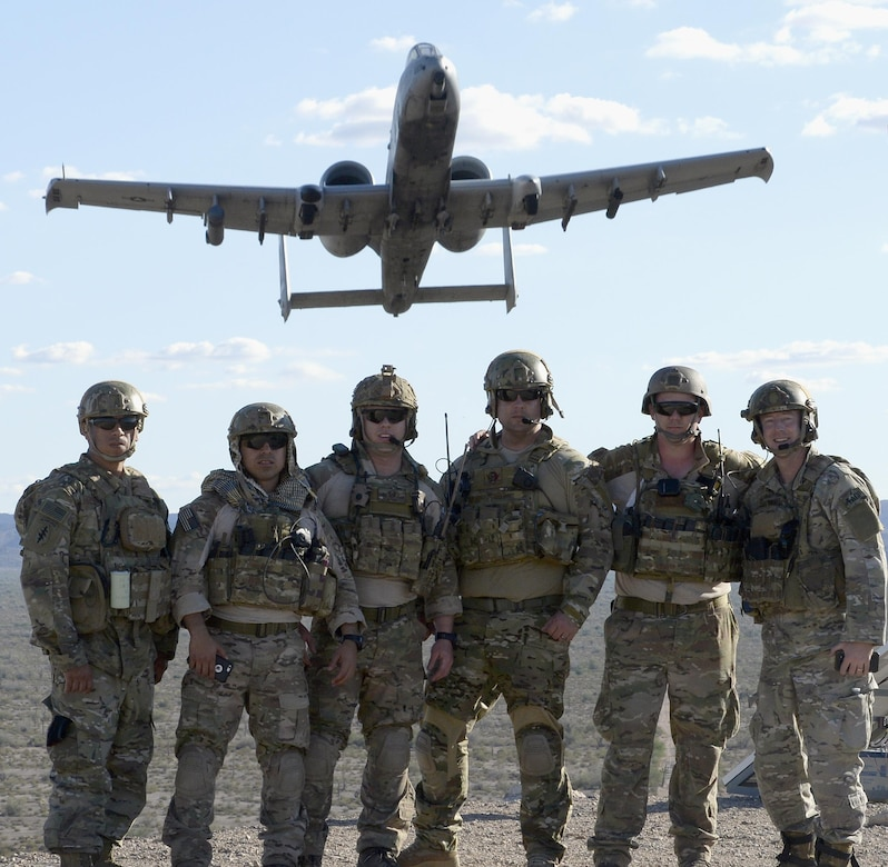 Tactical air control party members with the 147th Air Support Operations Squadron, 147th Reconnaissance Wing, pose as a 357th Fighter Squadron A-10 Warthog from Davis Monthan Air Force Base, Arizona, flies overhead April 12, 2016. The battlefield Airmen traveled to the desert range in Gila Bend for a weeklong simulated deployment with their Czech partners.