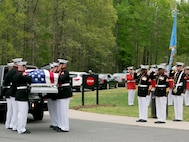 Sgt. Maj.  Ronald L. Green (left), Sergeant Major of the Marine Corps, and Master Gunnery Sgt. Leonard Spain (right), funeral director, Marine Barracks Washington, D.C., render honors as the Body Bearers from Bravo Co. conduct a casket transfer during the funeral for Medal of Honor Recipient, Pfc. Hector A. Cafferata Jr. (USMCR) at Quantico National Cemetery, Va., April 22, 2016. According to Cafferata's Medal of Honor award citation, on Nov. 28, 1950 while serving as a rifleman with Fox Company, 2nd Battalion, 7th Marines, 1st Marine Division, during the Chosin Reservoir Campaign, Cafferata's fortitude, great personal valor, and dauntless perseverance in the face of almost certain death, saved the lives of several of his fellow Marines and contributed essentially to the success achieved by his company in maintaining its defensive position against tremendous odds. Cafferata passed away, April 12, 2016 at the age of 86. (Official Marine Corps photo by Cpl. Chi Nguyen/Released)