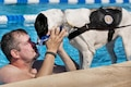 Eric Fisher, a Warrior Games athlete, plays with Lola, his military working dog, after a morning swim session as part of an adaptive sports camp at Eglin Air Force Base, Fla., April 7, 2016. This was the first time Williamson returned to the pool after a leg amputation. Air Force photo by Samuel King Jr.