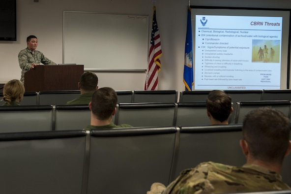 U.S. Air Force Senior Airman Aaron Bachtell, 23d Medical Operations Squadron public health technician, briefs deploying Airmen, April 21, 2016, at Moody Air Force Base, Ga. Bachtell briefed Airmen about how to maintain their health while deployed overseas. (U.S. Air Force photo by Airman 1st Class Lauren M. Hunter/Released)
