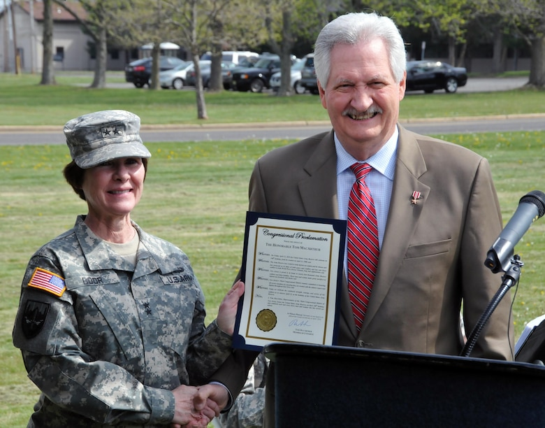 """Maj. Gen. Margaret W. Boor, commanding general of the U.S. Army Reserve's 99th Regional Support Command, left, receives a congressional proclamation from Bob Smyth, former Army Reserve Soldier and field representative for U.S. Congressman Tom MacArthur (NJ-3), during the Army Reserve 108th birthday celebration April 22 on Joint Base McGuire-Dix-Lakehurst, New Jersey. """"The Army Reserve has protected us in times of peace and conflict, and has sent brave Soldiers to both World Wars, Korea, Vietnam, Iraq, and Afghanistan,"""" said Smyth as he read the proclamation."""