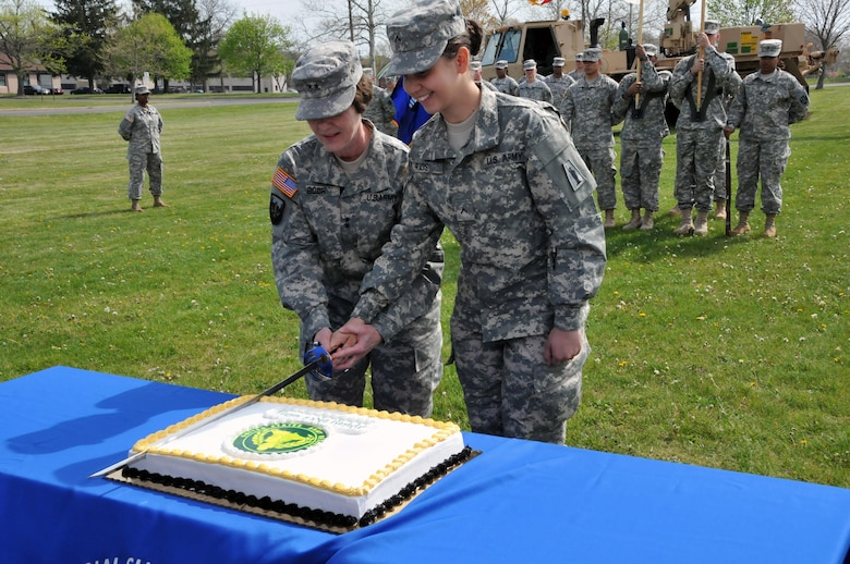 """Maj. Gen. Margaret W. Boor, commanding general of the U.S. Army Reserve's 99th Regional Support Command, left, and Pvt. Katherine Rios-Cuartas of the Army Reserve's 77th Sustainment Brigade cut the Army Reserve birthday cake during the Army Reserve 108th birthday celebration April 22 on Joint Base McGuire-Dix-Lakehurst, New Jersey. """"We salute all those who have served, and continue to serve – Soldiers, Civilians and their Families – for their remarkable dedication to our country,"""" Boor said."""