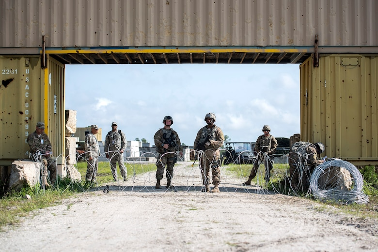 Airmen set up an entry control point during Spartan Warrior week April 14, 2016, Avon Park Air Force Range, Fla. Participants were graded on their ability to set-up and defend an entry control point. (U.S. Air Force photo by Airman 1st Class Janiqua P. Robinson/Released)