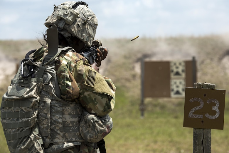 U.S. Air Force Senior Airman Niya Law, 823d Base Defense Squadron fireteam member, fires an M4 carbine April 13, 2016, at Avon Park Air Force Range, Fla. During Spartan Warrior week Airmen assigned to various squadrons across the U.S. competed against one another for medals, bragging rights and a trophy. (U.S. Air Force photo by Airman 1st Class Janiqua P. Robinson/Released)