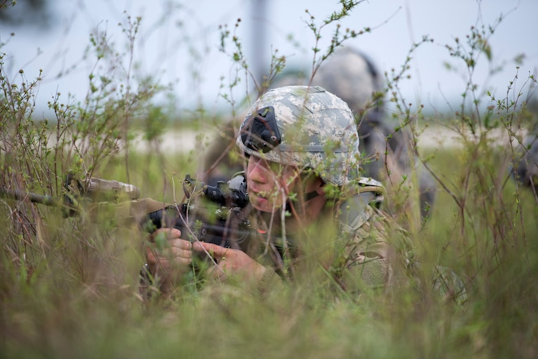 U.S. Air Force Tech Sgt. Brian Marshall, 823d Base Defense Squadron NCO in charge of training, provides cover for his team during a care under fire scenario, April 13, 2016, at Avon Park Air Force Range, Fla. Airmen had to rescue a simulated causality, provide self-aid buddy care, and get the causality to safety. (U.S. Air Force photo by Airman 1st Class Janiqua P. Robinson/Released)
