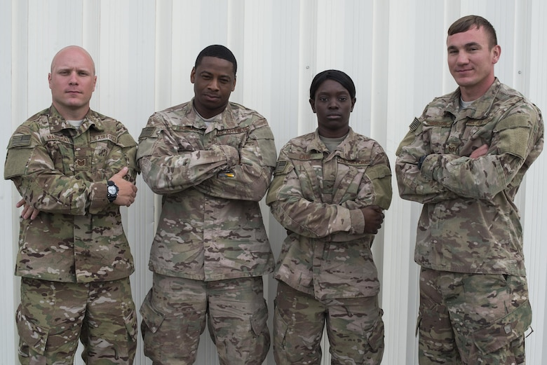U.S. Air Force Airmen from the 823d Base Defense Squadron pose for a photo, April 15, 2016, at Avon Park Air Force Range, Fla. Spartan Warrior week allowed Airmen assigned to various squadrons across the U.S. to split into teams of four and compete in generalized and career based challenges. (U.S. Air Force photo by Airman 1st Class Janiqua P. Robinson/Released)