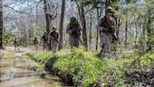Students at the Marine Military Police Basic Course and the new Marine Military Police Officer Basic Course patrol during a field exercise at Fort Leonard Wood, Missouri, April 14, 2016. The exercise tests the Marines readiness for tasks they may be required to do in the fleet.