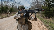 A student at the Marine Military Police Basic Course provides security while on patrol during a field exercise at Fort Leonard Wood, Missouri, April 14, 2016. Marines in this course learn how to properly provide security when on mounted and foot patrols.