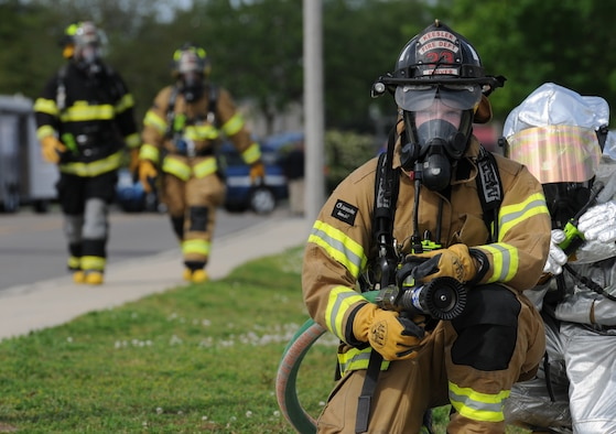 Senior Airman Codee Potts, 81st Infrastructure Division firefighter, prepares to use a fire hose during a Chemical, Biological, Radiological, Nuclear and Explosive exercise scenario, April 21, 2016, Keesler Air Force Base, Miss. The Force Protection Condition exercise scenario simulated an intruder entering the hazardous waste 90-day accumulation site, where an explosion occurred causing a mass casualty event. The exercise tested the base's capability to react to and recover from a mass casualty event. (U.S. Air Force photo by Kemberly Groue)