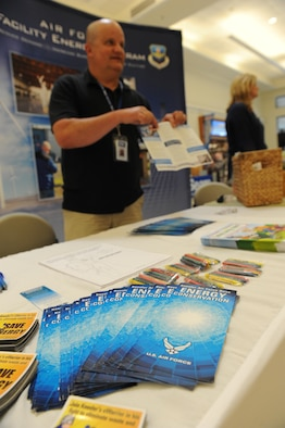 Bruce Groves, Base Operations Support energy manager, passes out informational recycling pamphlets at the base exchange April 22, 2016, Keesler Air Force Base, Miss.  The Base Operations Support energy program and environmental office set up a booth with hand-outs and literature materials about recycling and environmental sustainability for Keesler personnel in recognition of Earth Day. Recycling bins, decorated by the children from the child development center, were also on display. (U.S. Air Force photo by Kemberly Groue)