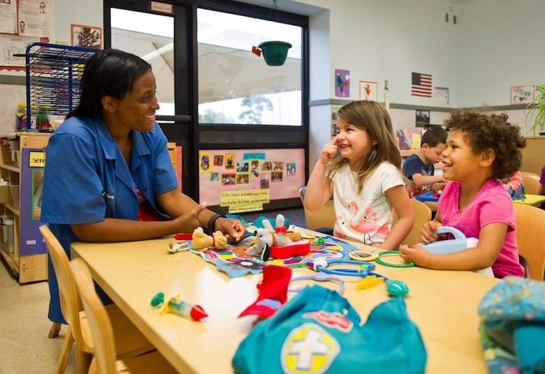 Deidre King, 325th Force Support Squadron Child Development Center caretaker, interacts with two of the children in the facility April 13, at the CDC. The CDC is charged with taking care of children belonging to members of Team Tyndall during the day. The facility maintains high expectations of its employees, providing them training consistent with current Air Force standards.  (U.S. Air Force photo by Senior Airman Dustin Mullen/Released)