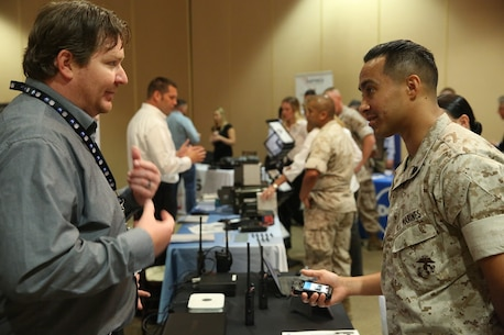 "MARINE CORPS BASE CAMP PENDLETON, Calif. – Sgt. Jesus Maldonado engages in conversation about radio equipment at the Pacific Views Events Center during the ""Tactical & Technology Day"" on Camp Pendleton April 20, 2016. This exhibition gives Marines an opportunity to present feedback to companies about their experience with equipment produced by the each organization. Maldonado is a training chief with the Comptroller's office, 1st Marine Division, and is a Perth Amboy, N.J. native. (U.S. Marine Corps photo by Lance Cpl. Shellie Hall/ Not Released)"