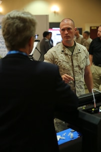 "MARINE CORPS BASE CAMP PENDLETON, Calif. – Sgt. David Matlock learns about a 3-D laser printer at the Pacific Views Events Center during the ""Tactical & Technology Day"" on Camp Pendleton April 20, 2016.  More than 20 companies from around the country attended the event where they showcased their current and future technologies and received user feedback. Matlock is a radio technician with 3rd Assault Amphibian Battalion, 1st Marine Division, and is a Calhoun, Ga. native. (U.S. Marine Corps photo by Lance Cpl. Shellie Hall/ Not Released)"