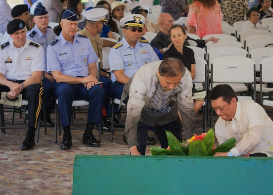 """U.S. Air Force Maj. Gen. Thomas Harwood III (second from left), Mobilization Assistant to the commander of Pacific Air Forces, looks on as honored guests lay a wreath at the 74th Commemoration of """"Araw ng Kagitingan"""" (Philippine Day of Valor), April 16, 2016, at the National Memorial Cemetery of the Pacific in Honolulu, Hawaii. The memorial ceremony honored Filipino-American veterans of World War II and is held on the anniversary of the fall of Bataan, and the Bataan Death March which claimed approximately 10,000 Filipino and American lives in April of 1942. (Photo courtesy of the Philippine Consulate General Honolulu)"""