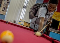 Roderick Rose Jr., 15, lines up a shot on a billiard table inside the Youth Center at Holloman Air Force Base, N.M. on April 1. Rose is the president of the Holloman's Keystone Club – an organization dedicated on building character and leadership skills in teens. He was recently nominated to participate in a national-level competition that recognizes outstanding young adults. (U.S. Air Force photo by Airman 1st Class Randahl J. Jenson)