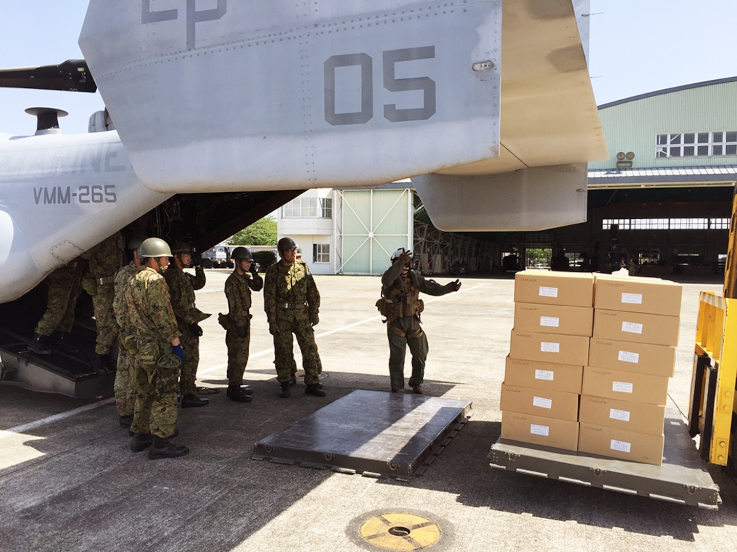 KUMAMOTO, Japan (April 22, 2016) - A 31st Marine Expeditionary Unit (MEU) Marine guides a pitch fork lift truck as Japan Self-Defense Force (JSDF) members prepare to load relief supplies onto a MV-22B Osprey from the Marine Medium Tiltrotor Squadron 265 (Reinforced), 31st MEU at Kumamoto Airport.  The supplies are in support of the JSDF-led relief effort after a series of earthquakes struck the island of Kyushu. The 31st MEU is the only continually forward-deployed MEU and remains the Marine Corps' force-in-readiness in the Indo-Asia-Pacific region.