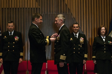 """BANGOR, Wash. (April 20, 2016) """" Capt. Michael Lewis, from Bend, Oregon, receives the Legion of Merit medal from Rear Adm. David Kriete, commander, Submarine Group Nine, during a change of command ceremony for the Gold Crew of the guided-missile submarine USS Ohio (SSGN 726). During the ceremony, held at the Bangor Chapel, Lewis turned over command to Capt. Gerald Miranda, from San Diego, California. (U.S. Navy photo by Mass Communication Specialist 2nd Class Amanda R. Gray/Released)"""