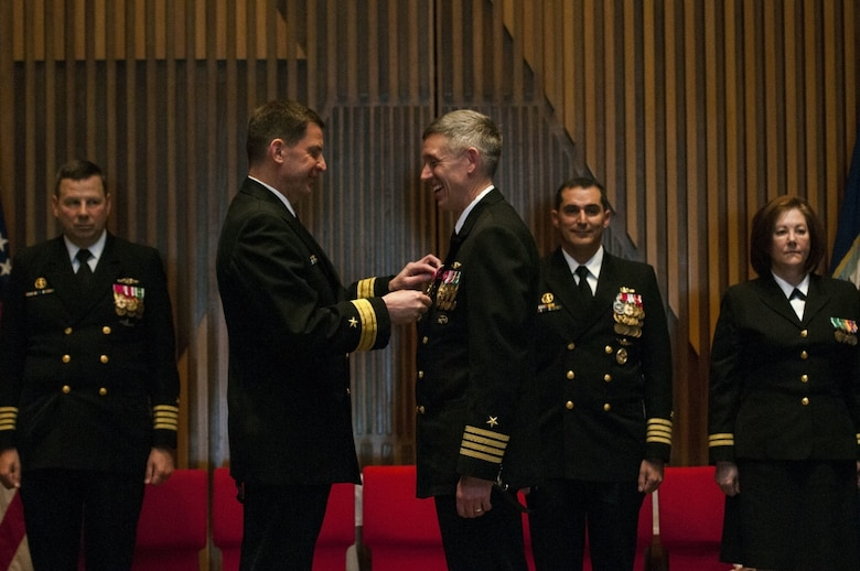 "BANGOR, Wash. (April 20, 2016) "" Capt. Michael Lewis, from Bend, Oregon, receives the Legion of Merit medal from Rear Adm. David Kriete, commander, Submarine Group Nine, during a change of command ceremony for the Gold Crew of the guided-missile submarine USS Ohio (SSGN 726). During the ceremony, held at the Bangor Chapel, Lewis turned over command to Capt. Gerald Miranda, from San Diego, California. (U.S. Navy photo by Mass Communication Specialist 2nd Class Amanda R. Gray/Released)"