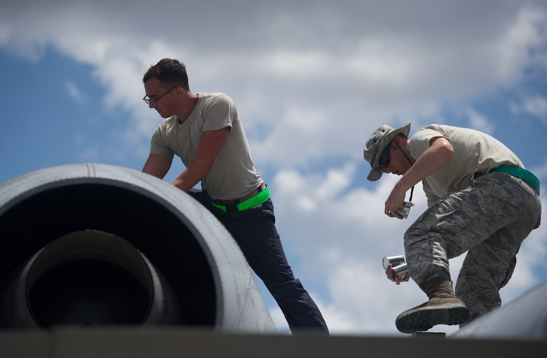 U.S. Air Force Senior Airman Matthew Rentschler, A-10 Thunderbolt II crew chief, and Staff Sgt. Joseph Defino, aerospace propulsion technician, both deployed from Osan Air Base, Republic of Korea, check the engine of an A-10C after the aircraft completed maritime domain awareness mission over the waters west of the Philippines April 21, 2016. The aircraft and Airmen are deployed in support of the first iteration of U.S. Pacific Command's Air Contingent, which was stood up at the invitation of the Philippine government in order to promote interoperability, build upon the relationship with our Philippine counterparts, and reaffirm the U.S. commitment to the Indo-Asia-Pacific region. (U.S. Air Force photo by Capt. Susan Harrington)