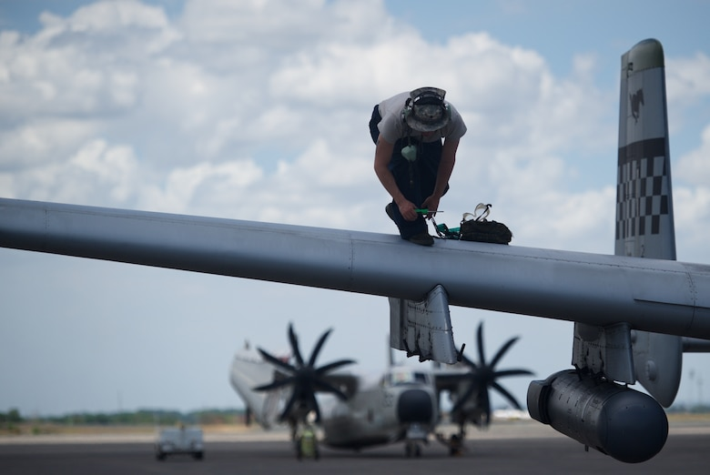U.S. Air Force Staff Sgt. Arrec Chetwood tightens a screw on the wing of an A-10C Thunderbolt II after the aircraft conducted a mission in the vicinity of Scarborough Shoal providing transparent air and maritime situational awareness April 21, 2016, at Clark Air Base, Philippines. Chetwood, who is deployed from Osan Air Base, Republic of Korea, is part of the first iteration of U.S. Pacific Command's Air Contingent, which was stood up at the invitation of the Philippine government in order to build upon the relationship with Philippine counterparts, and lay the foundation for joint air patrols to complement ongoing joint maritime patrols. (U.S. Air Force photo by Capt. Susan Harrington)
