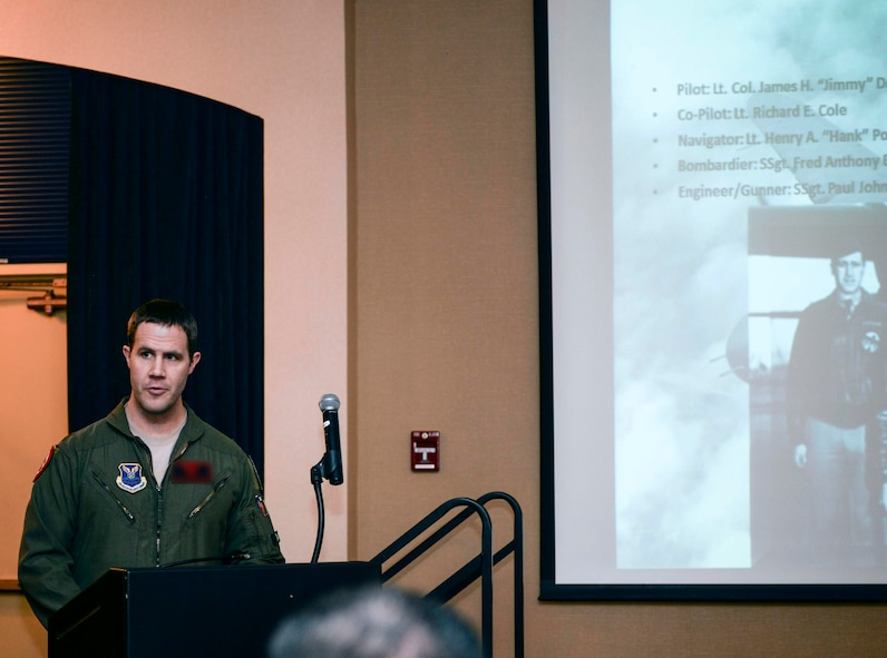 Maj. Brian, 34th Bomb Squadron assistant director of operation instructor pilot, speaks about the first crew of the Doolittle Raid during the Doolittle Raider toast ceremony at Ellsworth Air Force Base, S.D., April 18, 2016. Lt. Col. James Doolittle launched 16 B-25 aircraft for the Doolittle Raid, leading 80 pilots who were the first to fly bomber aircraft from a carrier deck, USS Hornet, and led to the first victory of World War II. (U.S. Air Force photo by Airman 1st Class Sadie Colbert/Released)