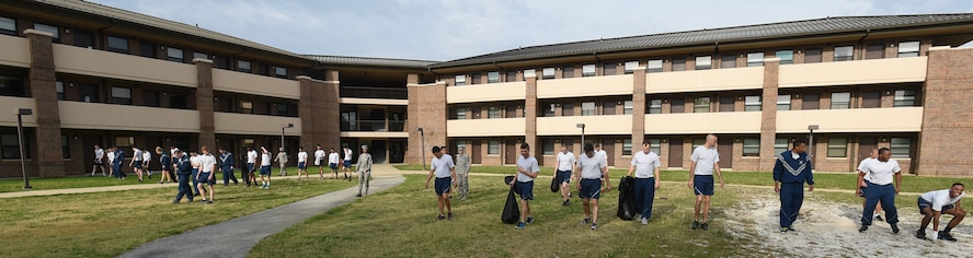 Team Andrews Airmen pick up trash and weeds around their dorm building at Joint Base Andrews, Md., April 22, 2016. Team Andrews cleaned up around base in commemoration of Earth Day. (U.S. Air Force photo by Senior Airman Joshua R. M. Dewberry/RELEASED)