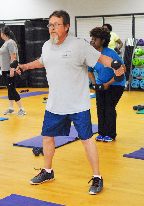 """Timothy Keister, a 448th Supply Chain Management Wing Unit Control Center program analyst, participates in Health and Wellness Center's """"Better Body Better Life"""" class April 14. He credits the class and what he's learned with helping him lose 16 pounds. (U.S. Air Force photo by Misuzu Allen)"""