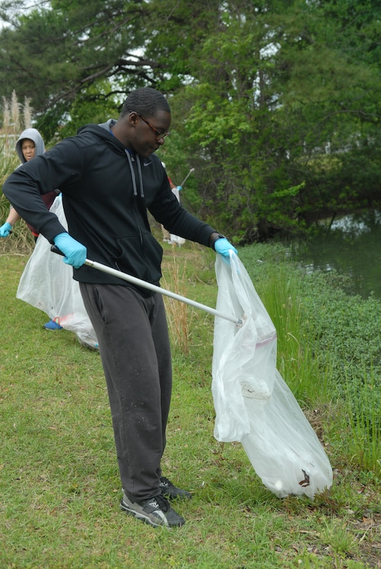 Airman 1st Class James Harris, 116th Aviation resource management, picks up trash during the Scout and Luna Lakes clean up day, April 15. (U.S. Air Force photo by Misuzu Allen)