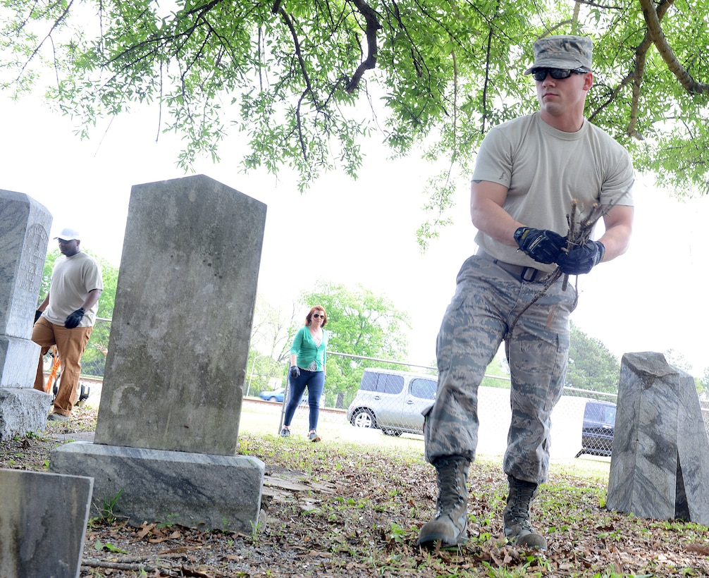 Senior Airman Will Jenkins, 116th Air Control Wing maintenance squadron, helps with the Bryant Cemetery clean up, April 20, 2016. (U.S. Air Force photo by Tommie Horton)