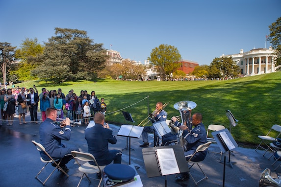A Ceremonial Brass quintet performs for visitors on the White House lawn during the Spring 2016 White House Garden Tour under the direction of Maj. Matthew Henry. The band has performed for this event many times since its beginning in 1972. (U.S. Air Force photo by Technical Sgt. Matthew Shipes).