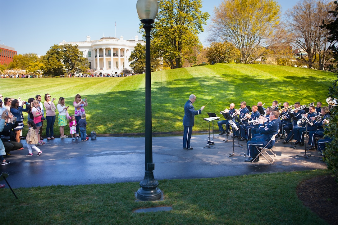 The Ceremonial Brass performs for visitors on the White House lawn during the Spring 2016 White House Garden Tour under the direction of Maj. Matthew Henry. The band has performed for this event many times since its beginning in 1972. (U.S. Air Force photo by Technical Sgt. Matthew Shipes).