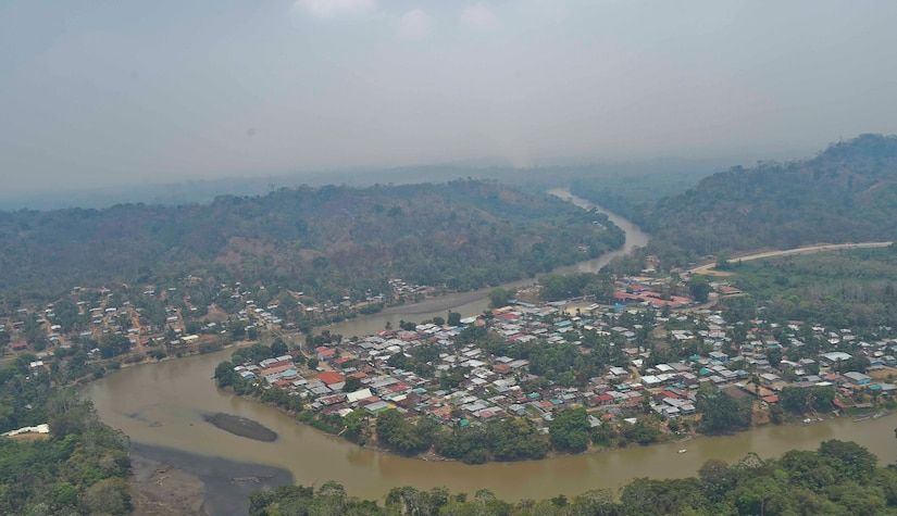 A town in the Darién province of Panama is seen overhead from a Joint Task Force-Bravo helicopter, with smoke from a wildfire surrounding it, April 18, 2016. Members of JTF-Bravo partnered with Panamanian Public Forces to contain multiple life-threatening wildfires in the region. Approximately 45,000 people reside in the Darién Province so stopping the spread of the fire from the undeveloped swampland and forests to residential areas was of utmost importance. (U.S. Air Force photo by Staff Sgt. Siuta B. Ika)