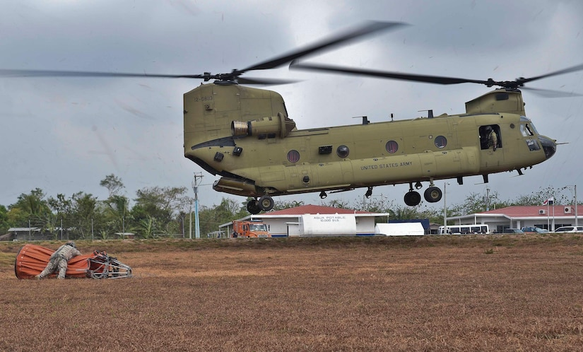 U.S. Army Staff Sgt. John Fajota, 1st Battalion, 228th Aviation Regiment CH-47 Chinook crew chief, preps a Bambi Bucket for connection to a Chinook during a firefighting operation in the Darién province of Panama, April 18, 2016. The Chinook's Bambi Bucket can hold up to 2,000 gallons of water. (U.S. Air Force photo by Staff Sgt. Siuta B. Ika)