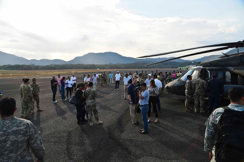 Members of the Panamanian Public Forces and local media gather during a visit from the U.S. Ambassador to Panama in the Arraiján District of Panama, April 17, 2016. The Panamanian firefighting operation comes less than a month after the 1-228th AVN sent air assets to help contain a fire near the town of Tela, Honduras. (U.S. Air Force photo by Staff Sgt. Siuta B. Ika)