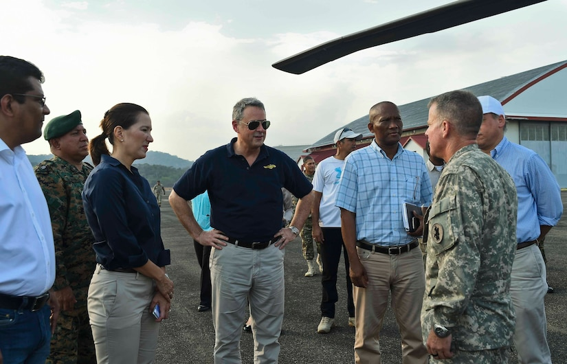 John Feeley (center), U.S. Ambassador to Panama, speaks to U.S. Army Lt. Col. Daniel Moore (right), 1st Battalion, 228th Aviation Regiment commander, during the ambassador's visit to the 1-228th AVN in the Arraiján District of Panama, April 17, 2016. The ambassador visited the 1-228th AVN to personally thank them for their firefighting efforts. (U.S. Air Force photo by Staff Sgt. Siuta B. Ika)