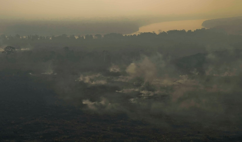 Wildfire scorches land in the Darién province of Panama, April 17, 2016. The fire, which is believed to have started April 4, grew exponentially, prompting the U.S. Embassy in Panama to request an aerial support package from JTF-B consisting of aircraft from the 1st Battalion, 228th Aviation Regiment, Soto Cano Air Base, Honduras, to help contain the fire. Approximately 45,000 people reside in the Darién Province, so stopping the spread of the fire from the undeveloped swampland and forests to residential areas was of utmost importance. (U.S. Air Force photo by Staff Sgt. Siuta B. Ika)