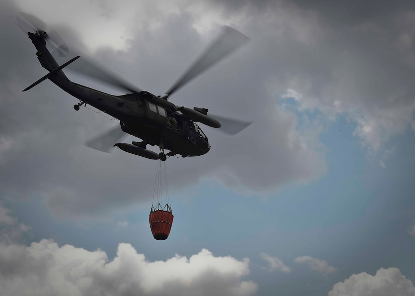 A UH-60 Black Hawk helicopter assigned to the 1st Battalion, 228th Aviation Regiment, Joint Task Force Bravo at Soto Cano Air Base, Honduras, carries a Bambi Bucket holding 700 gallons of water during a firefighting mission in the Darién province of Panama, April 17, 2016. The Bambi Bucket-equipped Black Hawk was ideal for this operation because of its ability to access areas unreachable by land firefighting crews and the volume of water each aircraft's Bambi Bucket can drop on a single pass. (U.S. Air Force photo by Staff Sgt. Siuta B. Ika)