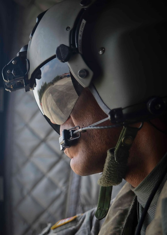 U.S. Army Chief Warrant Officer Sean Ellis, 1st Battalion, 228th Aviation Regiment CH-47 Chinook pilot, prepares for a firefighting mission in the Darién province of Panama, April 17, 2016. Ellis was one of approximately 25 Joint Task Force-Bravo members sent to Panama to help with the firefighting efforts against the fires, which are believed to have started April 4 and grew exponentially, prompting the Government of Panama, via the U.S. Embassy in Panama, to request an aerial support package from JTF-Bravo. (U.S. Air Force photo by Staff Sgt. Siuta B. Ika)